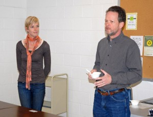 """Vance-Granville Community College graduate Ariel Greenwood (left) is introduced by VGCC Biology instructor Dr. Dan Settles, chairman of the Sustainability Committee, before her """"lunch and learn"""" presentation. (VGCC photo)"""