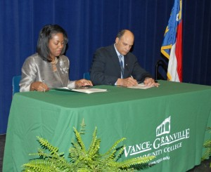 From left, Dr. Stelfanie Williams, the president of Vance-Granville Community College, and Harold L. Martin Sr., the chancellor of North Carolina A&T State University, sign the RN to BSN articulation agreement between the two institutions at a ceremony held in the VGCC Civic Center on Feb. 8. (VGCC photo)