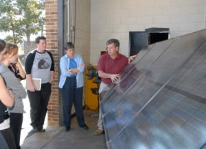 VGCC Electrical Systems Technology program head/instructor Robert Hudson (center) shows students a photovoltaic system, which uses solar panels to generate electricity. (VGCC photo)