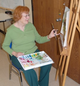 Lelia Brigham paints in an art classroom on VGCC's Main Campus.