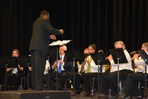 Ivory Brock conducts the Vance-Granville Community Band during the 2014 holiday concert. (VGCC photo)
