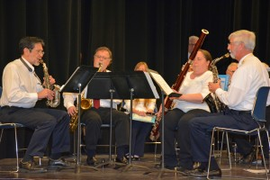 """From left, Tom Koinis of Oxford, Jeff Myers of Townsville, Tracie Winstead of Louisburg and Robert Bass of Henderson play traditional Christmas carols as the """"Old Vanguard Woodwind Quartet."""" (VGCC photo)"""