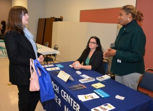 From left, VGCC Pharmacy Technology student Lindsay Henry of Wake Forest talks with Melissa Hill (seated) and Terri Grant Boyd (standing), representatives of Murdoch Developmental Center, during the Health Sciences Career Fair. (VGCC photo)