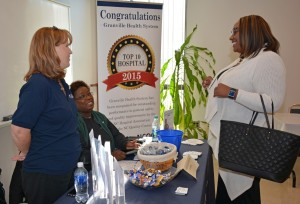 From left, Melanie Hobgood (standing) and Brenda Whitlock from Granville Health System talk with VGCC Associate Degree Nursing student Fara Vass of Henderson during the Health Sciences Career Fair. (VGCC photo)