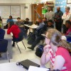 Local pastors listen to a classroom discussion during their tour of the STEM Early High School on the campus of Northern Vance High School.