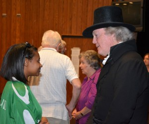 "VGCC student Latessa Wilkerson of Henderson talks with ""Thomas Jefferson"" (Bill Barker) at the conclusion of his lecture at the college (VGCC photo)."