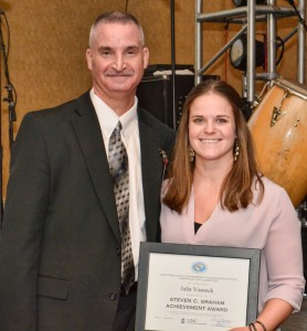 From left, VGCC Vice President of Finance and Operations Steven Graham presents the first award named in his honor to Julia Vosnock, Procurement Manager with the Cape Fear Public Utility Authority.
