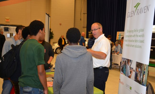 Todd Wemyss, site manager for Glen Raven in Norlina, speaks to local students during the Manufacturing Day event at VGCC in 2015. (VGCC photo)
