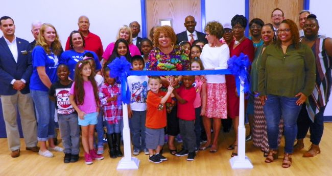 Shown at the Henderson-Vance Chamber of Commerce ribbon cutting for Carver Elementary School are, Vance County School officials; Principal, staff and students for Carver Elementary School; Family members of former Vance County Commissioner Eddie Wright; Chamber of Commerce staff and local elected leaders.
