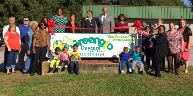 Shown at the Henderson-Vance Chamber of Commerce ribbon cutting for Greenglo Daycare Center are, Paul and Kelli Stennett, owners; Sheril Scott, director; and staff - Thelma Cooper, Brittany Roberts, Shelly McCurry; Teresa Hays, parent; Kimko Williams and Katrina Stokes, Smart Start; Patsy Rivers and Lynn Corbitt, Fidelity Bank; HVCC President John Barnes; Chamber Ambassador Tonya Moore, KARTS; Chamber Ambassador Kevin Bullock, WIZS 1450 Radio; Chamber Ambassador Cheryl Elman, Dave Elman Hypnosis Institute; Not Pictured: HVCC Director of Membership Services, Annette Roberson.