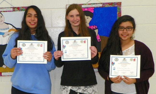The top three winners hold their certificates and include, from left, Ximena Rodriguez, Ashley Pendergrass and Emily Garcia.